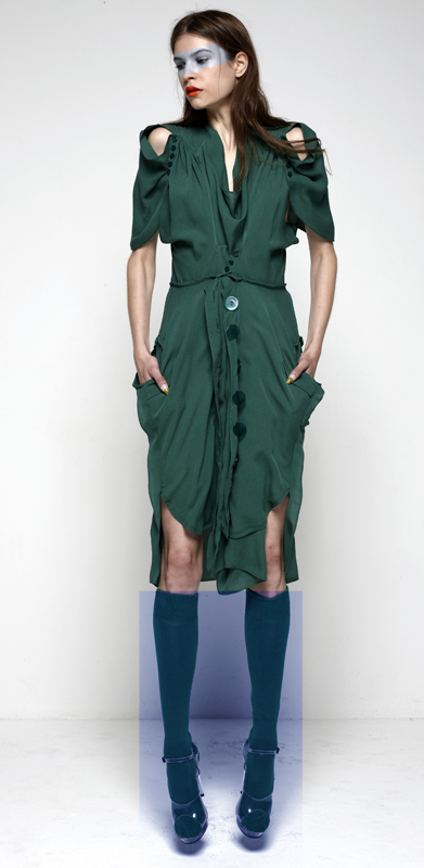 Future Classics fashion SS12 collection: Afrika E8 Look 6 Dark Green Silk Georgette Double Cape Sleeved Dress with XL Toy Perspex Buttons